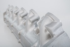 AluGuss Aue & Co. KG - Kleinserienfertigung Handformguss Ansaugrohr